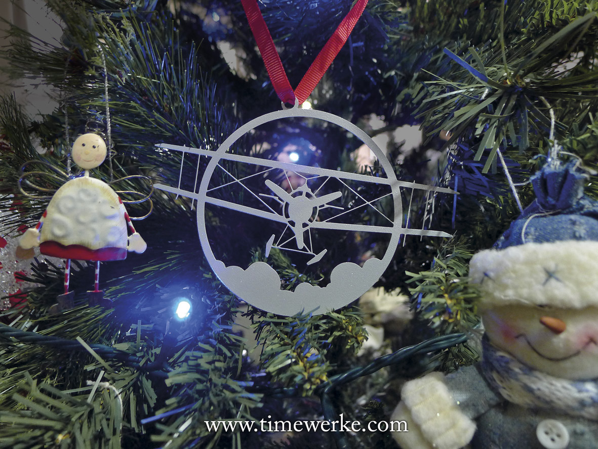 The metallic biplane decoration hanging on the Christmas tree was from an IWC Christmas received. Photo: TANG Portfolio