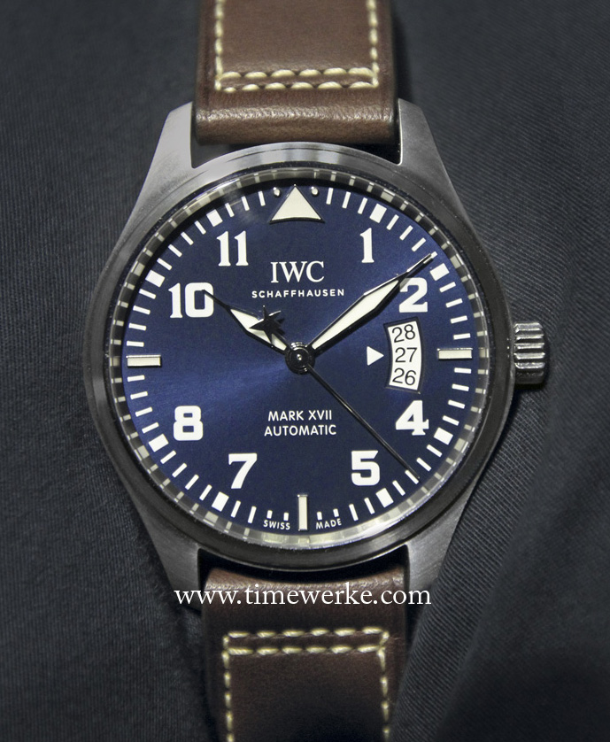 """The IWC Pilot's Watch Mark XVII Edition Le Petit Prince (Ref. IW326506) features a """"midnight blue"""" dial and was launched in 2013 to mark the 70th anniversary of Antoine de Saint-Exupéry's best-selling novel The Little Prince. The counterweight of the continuous sweep seconds hand is in the form of a star, a reference to the stars drawn and mentioned in the book. Limited to 1,000 pieces. Retailed at: 5,500 Swiss francs / 4,500 euros / US$6,000 / S$7,500 / 19,000 Malaysian Ringgit. Photo: © TANG Portfolio. 2013 Watches&Wonders, Hong Kong"""
