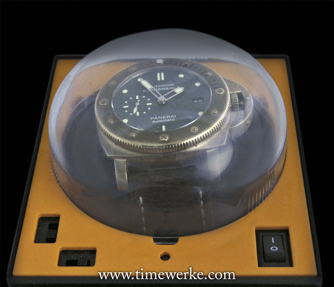 "This single unit Boxy Brick Winder (with an orange front panel and what is known as the ""deeper dome"") is able to comfortably house our 47mm Panerai Luminor Submersible 1950 3 Days Automatic Bronzo PAM00382. Note: Watch and winder are the property of the author. Photo: © TANG Portfolio"
