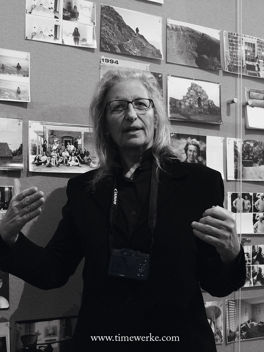 "Annie Liebovitz explaining her works at the ArtScience Museum at Marina Bay Sands Singapore on 16 April 2014. The strap slung around Leibovitz is for her Canon G16. Around 200 of Liebovitz's photographs are on display for: ""Annie Liebovitz: A Photographer's Life 1990 to 2005"" exhibition which began on 18 April 2014 and will end on 19 October 2014. Photo: © TANG Portfolio"
