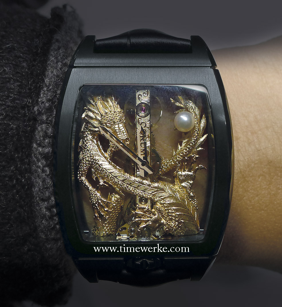 """Corum Golden Bridges Golden Bridge """"Dragon"""". Introduced in 2014 at the annual BaselWorld watch fair, the hand-engraved oriental dragon is encased in a black PVD-coated titanium case that also houses the Calibre C0 113 manual-winding movement. Photo: © TANG Portfolio. BaselWorld 2014"""