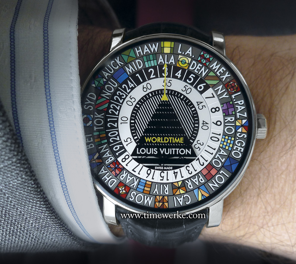 The Escale Worldtime on the wrist of Hamdi Chatti, vice president, Jewelry and Watches, Louis Vuitton. To read the time, look out for the vertical yellow arrow with its base at the tip of the triangle. The time is 3.55am in Alaska. Take note of the smallest disc indicating the minutes, the half-black, half-white central disc indicating the hours either during the day (white half: 7am to 6pm) or at night (black half: 7pm to 6am) and the cities which are indicated by their initials. Photo: © TANG Portfolio. Basel 2014.