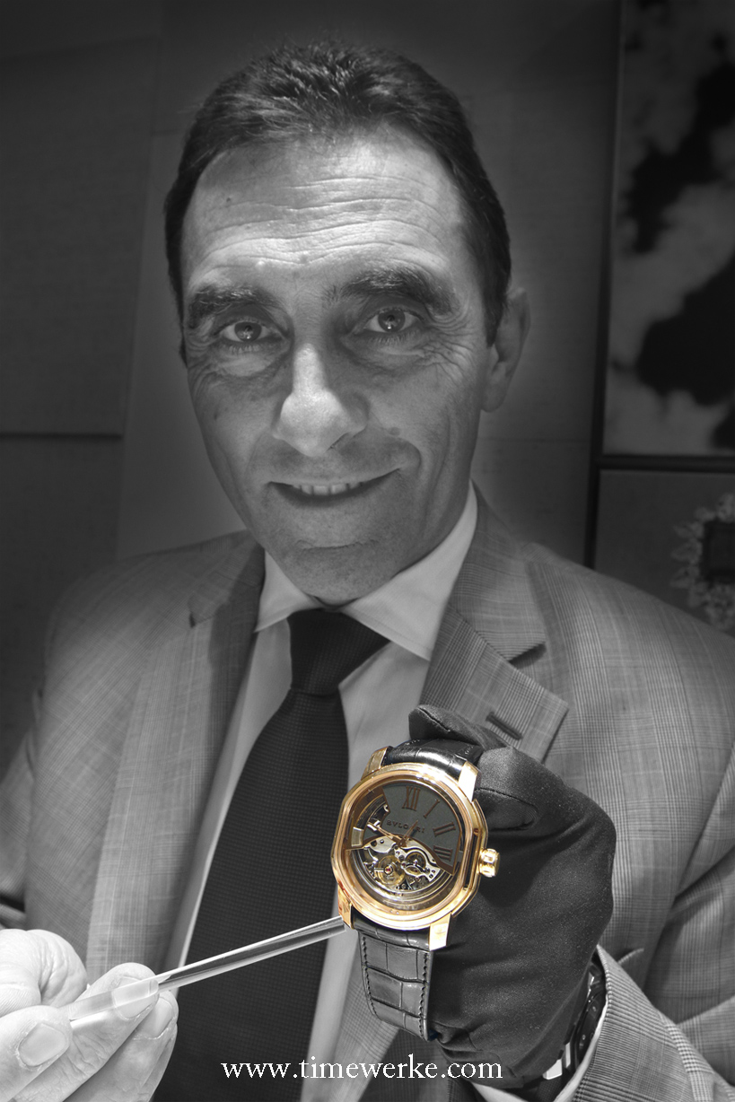 Andrea Granalli, director of high-end watches, Bulgari, is the caretaker for the L'Ammiraglio del Tempo on its travels around the world. He is pointing at the lug that has to be lifted up to activate the minute repeater. Photo: © TANG Portfolio. Timmy / Elfa 2014