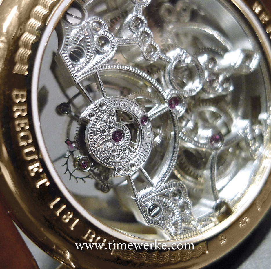 "In high horology, a skeletonised movement means that it has undergone the openworking process whereby as much material is removed as possible which results in thin bridges for example. Even the bridges are engraved and decorated. Try spotting the engraved text and numerals: ""Breguet No. 7988"". Photo: © TANG Portfolio. Elfa / Timmy. BaselWorld 2014"