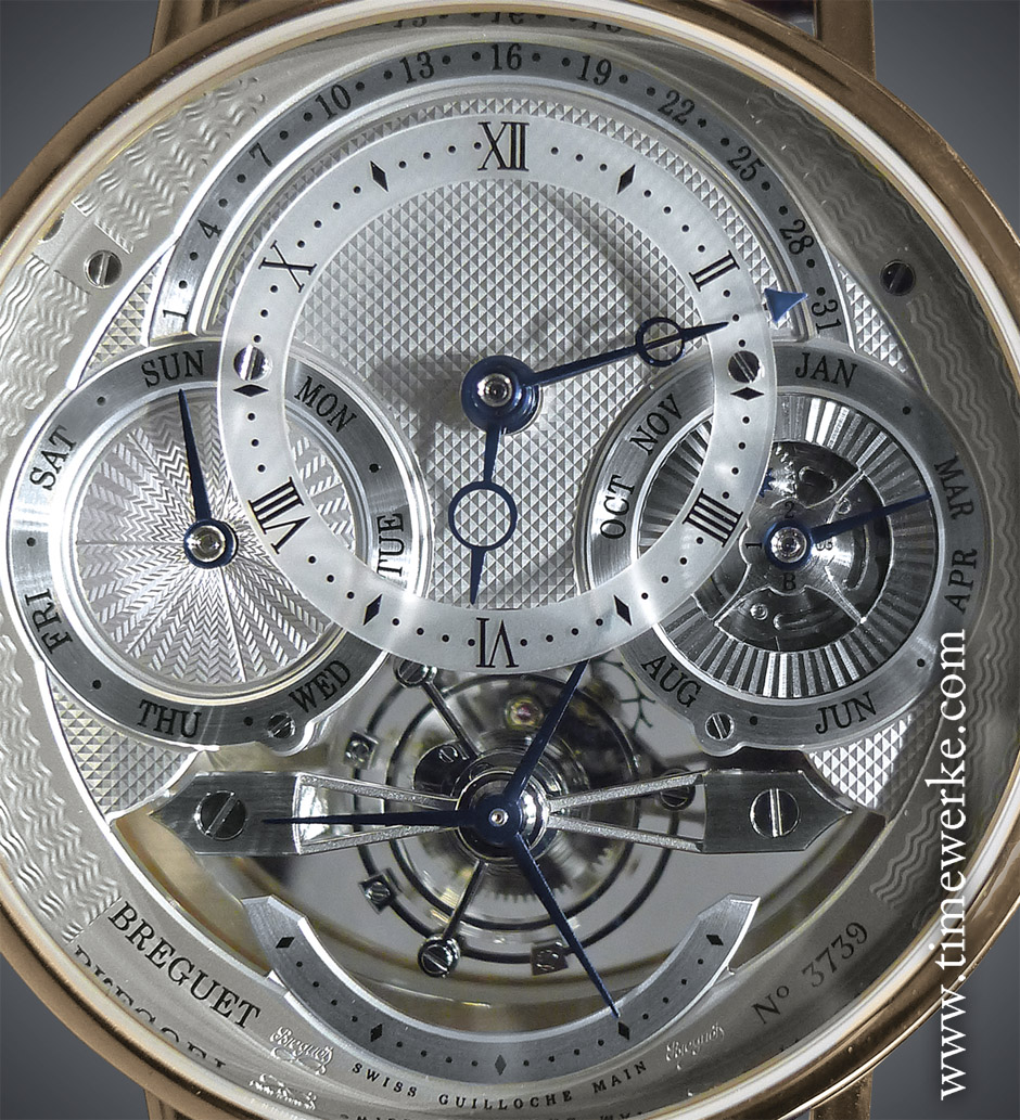 """The blued steel Breguet open-tipped hour and minute hands travel around the elevated sapphire disc chapter ring. At the 12 o'clock position is the retrograde date display. The day display is at 9 o'clock while the month indication is at 3 o'clock. The leap year indication is also at the 3 o'clock position. A revolving blue """"sun"""" will indicate the year and this is currently hidden by the chapter ring and above year """"2"""". The leap year is indicated when this blue sun is at the """"B"""" position which is year """"4"""". The tourbillon is at 6 o'clock and above it is the triple hand for the sweep seconds. From the example shown here, it is 12 past 6 on 30 March which is a Sunday. Photo: © TANG Portfolio. Elfa / Timmy. BaselWorld 2014"""