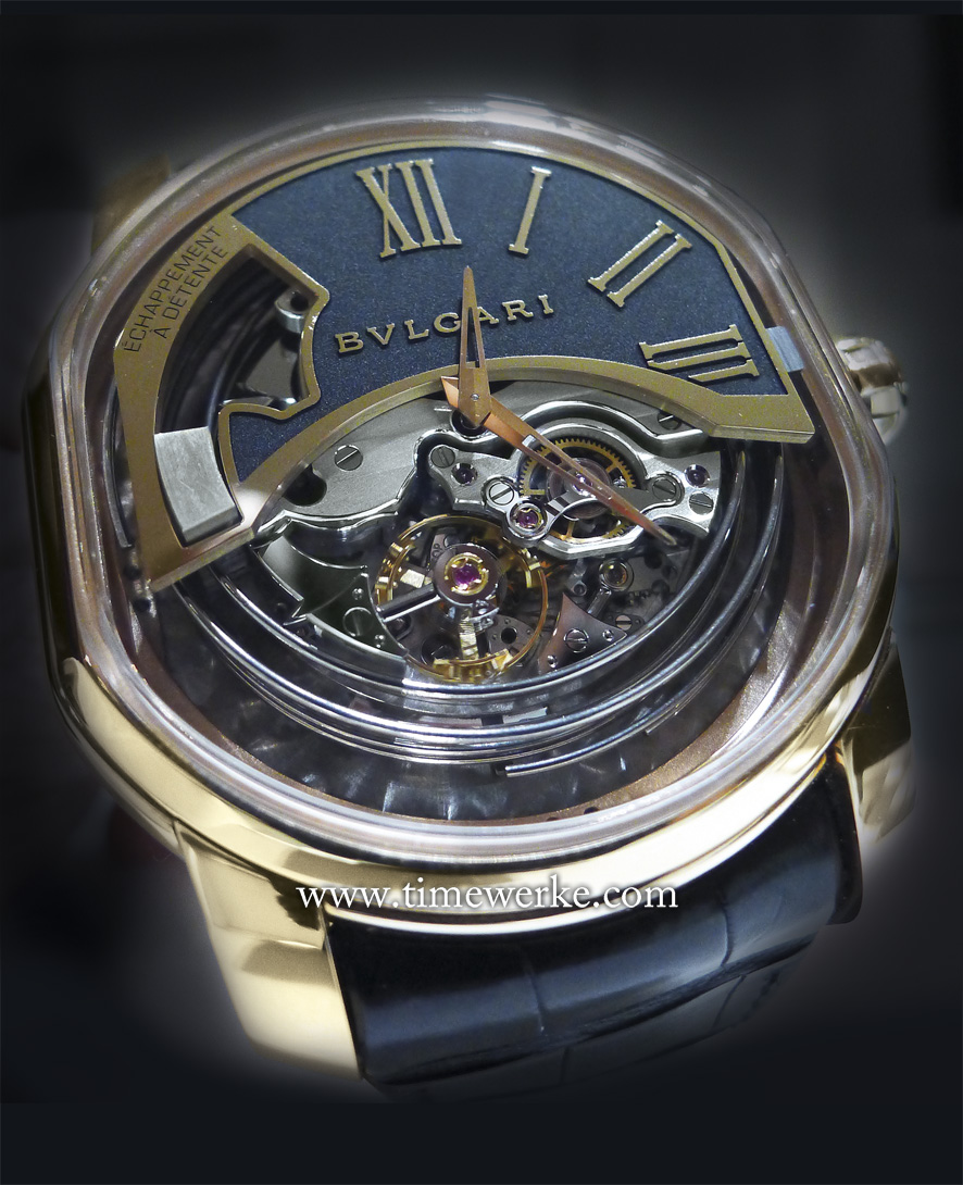 "Bulgari's L'Ammiraglio del Tempo - ""The Admiral of Time"" featuring a detent escapement with minute repeater and constant force mechanism was introduced at the 2014 BaselWorld annual watch fair. Production is limited to 20 pieces in 18K pink gold and 10 pieces in 18K white gold. Priced at US$359,000 or around CHF350,000 / SGD490,000 / MYR1,172,000 (Malaysian Ringgit). The prototype was recently in store – at Bulgari's new boutique at Marina Bay Sands in Singapore for a few days only. The hammers and Cathedral gongs are visible but where is the sliding mechanism for activating the minute repeater? Photo: © TANG Portfolio. Timmy / Elfa 2014"