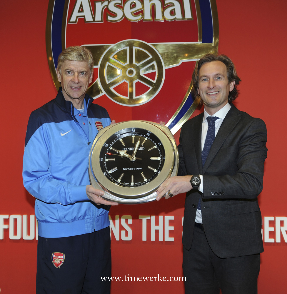 Arsenal manager Arsène Wenger who joined the football club in 1996 holding the JeanRichard clock together with Bruno Grande, managing director, JeanRichard. Photo: © JeanRichard