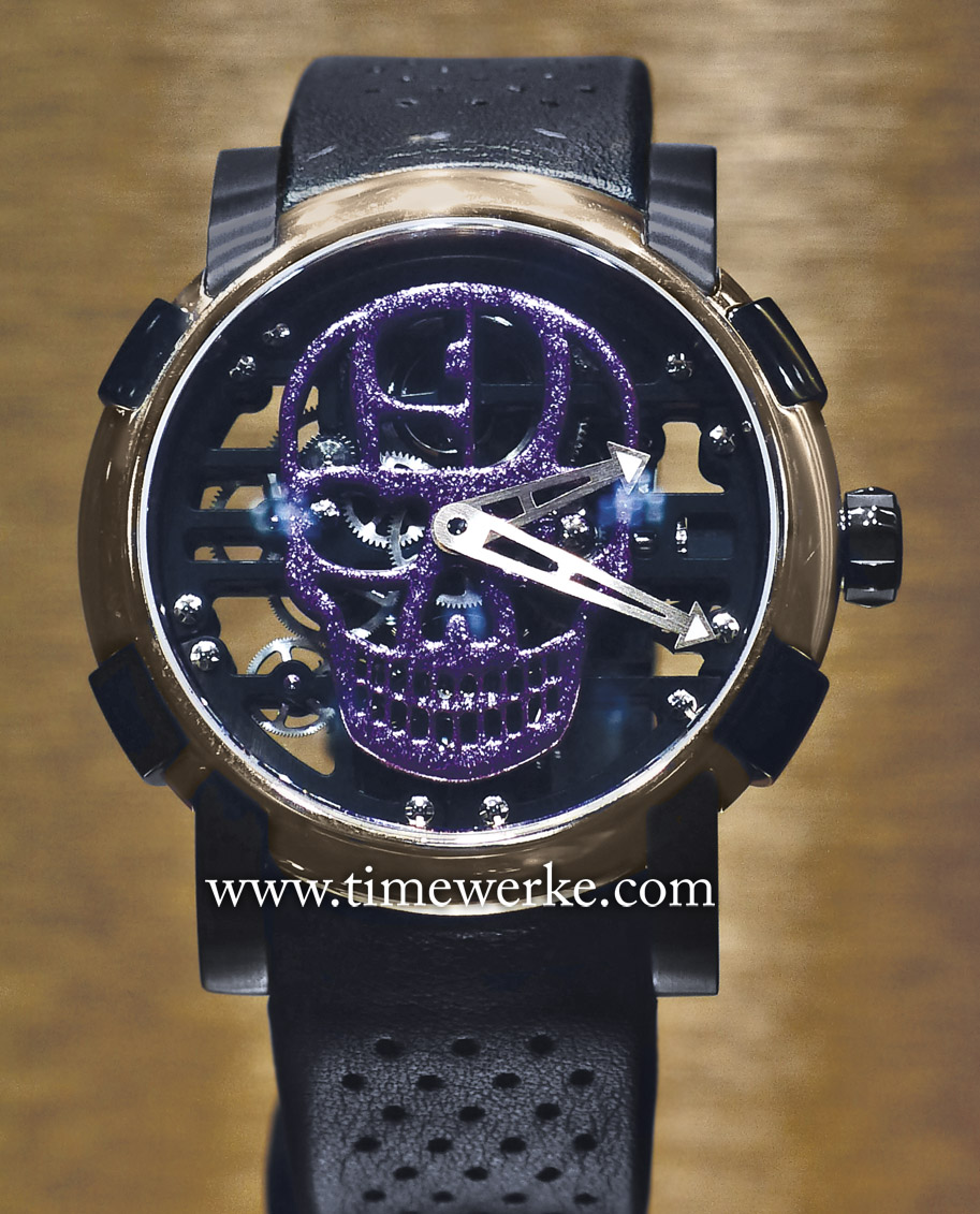 "RJ-Romain Jerome H9C-DNA wristwatch featuring the skull painted in purple/ metal flake colour. It comes with a black ""guidoline"" calf strap with black PVD-coated satin-finished pin buckle. This pièce unique watch was sold together with the 1943 WLC Harley-Davidson bike customised by Hardnine Choppers. Retail price of the watch and motorbike: CHF110,000. Photo: © TANG Portfolio. 2014 BaselWorld"