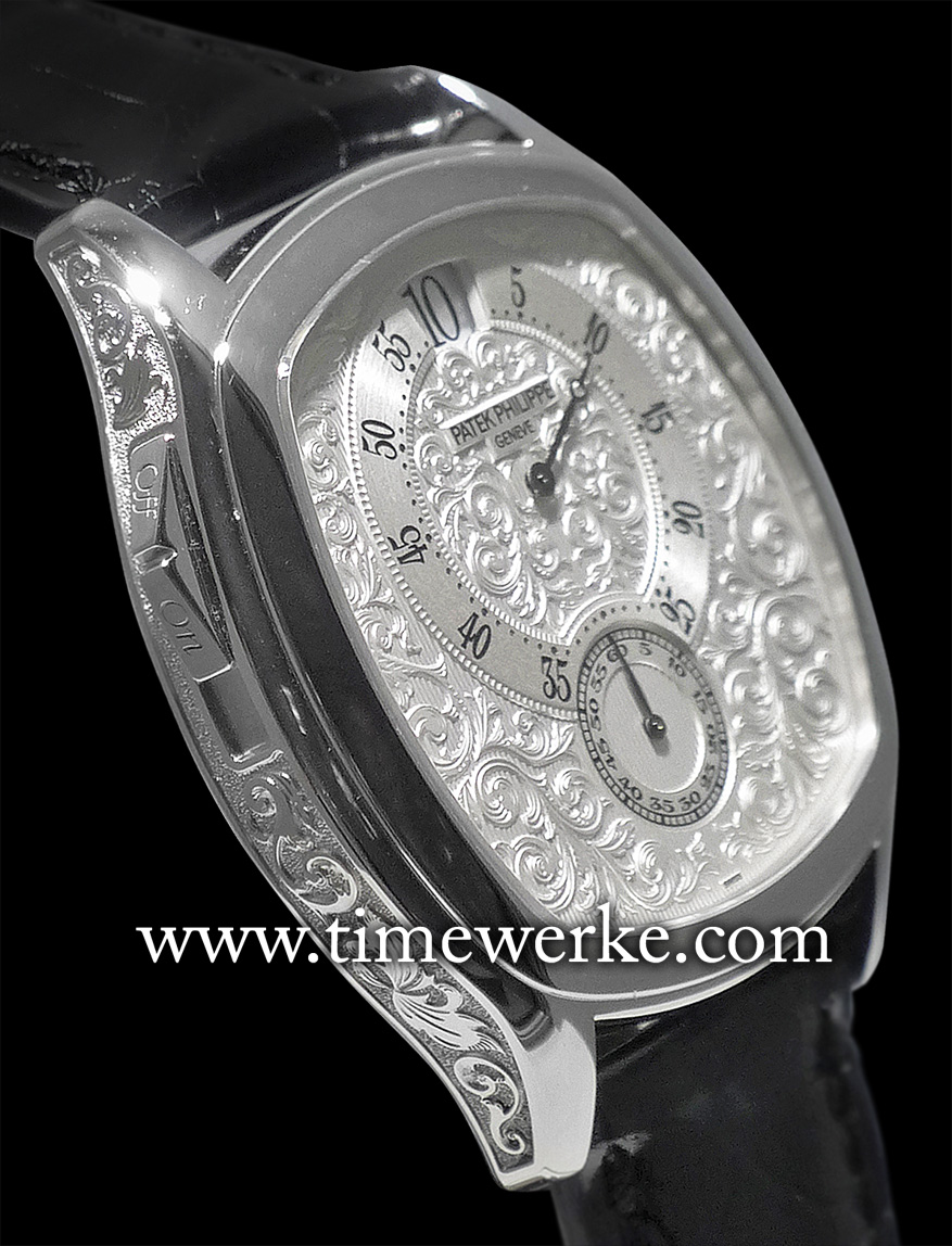 "The dial on this Ref. 5275 tonneau-shaped case and its case band are decorated with hand-engraved floral motifs. At the case flank is an on-off slide. In the ""off"" position, the hammer is isolated and the automatic hour strike is disabled. Photo: © TANG Portfolio. Elfa / Timmy. October 2014, Geneva"