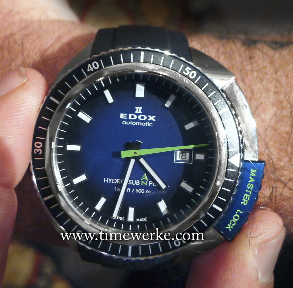 Edox Hydro-Sub 50th Anniversary Limited Edition on the wrist of Christian Redl. This black, blue and green watch commemorates the 50th anniversary of the Hydro-Sub (1965 to 2015). Housed in the 46mm stainless steel case is the Calibre 80 automatic movement (base Sellita SW 200). The Hydro-Sub 50th Anniversary is water-resistant to 500 metres and is limited to 515 pieces. The Master Lock (at the 3 and 4.30 positions) is in the closed position and it protects the crown. Photo: © TANG Portfolio. Elfa / Timmy. May 2015