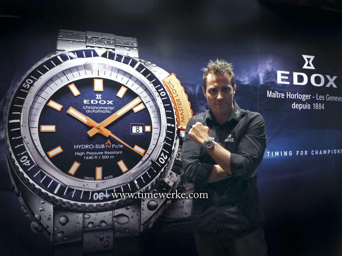 Christian Redl with the poster of the Edox Hydro Sub North Pole Limited Edition beside him. The Edox Hydro Sub North Pole Limited Edition commemorates the 130th anniversary of the brand's founding (1884 to 2014). It is powered by the Edox Calibre 802 automatic movement, base Sellita SW 200. It is water-resistant to 500 metres and is limited to 350 pieces. Priced at SGD4,119.50. Photo: TANG Portfolio. Elfa / Timmy. May 2015