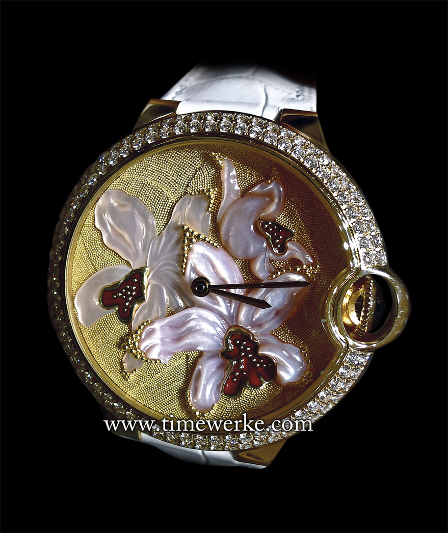 Orchid Granulation and engraved mother-of-pearl motif Ballon Bleu de Cartier 42mm watch. Introduced in 2015, this orchid granulation watch has an automatic movement and 22K yellow gold granulation on its 18K yellow gold dial. The  orchid motif is in engraved mother-of-pearl and has 18K yellow gold flower petals covered in red enamel. Limited to 40 pieces. Photo: © TANG Portfolio. Elfa / Timmy. 2015 Salon International de la Haute Horlogerie.
