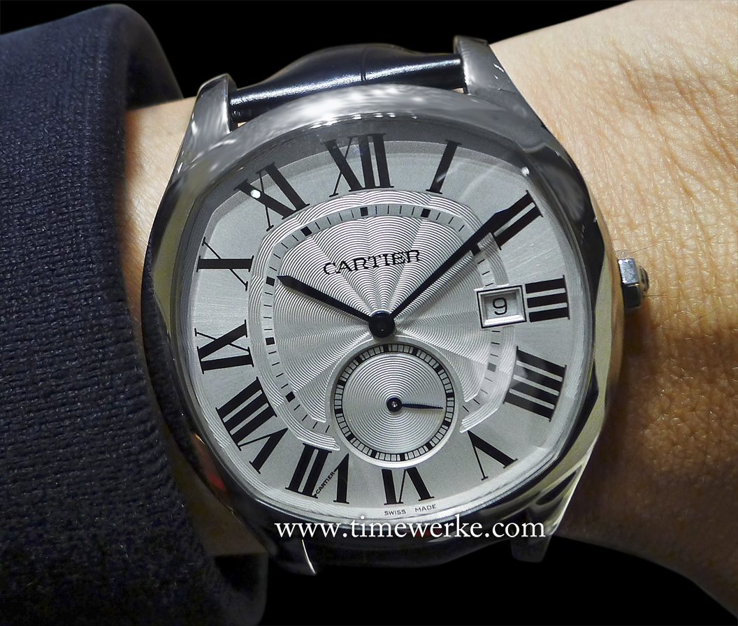 Drive de Cartier watch. Introduced in 2016, it houses Cartier's Manufacture Calibre 1904-PS MC automatic movement and features the sweep seconds counter at six o'clock and the date display. Photo: © TANG Portfolio. Elfa / Timmy. 2016 Salon International de la Haute Horlogerie.