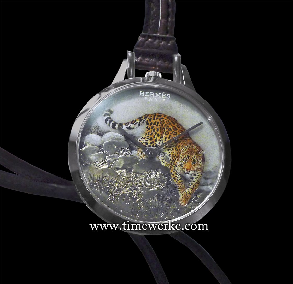 Slim d'Hermès Pocket Panthère. Introduced at the 2016 BaselWorld watch fair, this is a one-of-a-kind pocket watch featuring an engraved and enamelled white gold dial depicting a panther that is based on a painting by famed French wildlife artist Robert Dallet (1923 to 2006). Housed within its 45mm diameter white gold pocket watch case is the Hermès Manufacture Calibre H1950 automatic movement with 42 hours of power reserve. The case is water-resistant to 3 bar (30m) and comes with the pocket watch comes with a cord strap and pouch in matt havana leather. Photo: © TANG Portfolio. Elfa / Timmy. BaselWorld 2016.