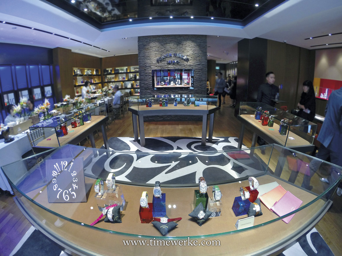 "Inside the Franck Muller Boutique at Isetan, Wisma Atria. The store features the brand's home-style concept with floor space carefully ""divided"" into areas like a ""living room"" , a ""drawing room"", a ""library"" and even a ""dining room"" (to the left with the long dining table). Photo: © TANG Portfolio / TimeWerke. Elfa / Timmy. 2016."